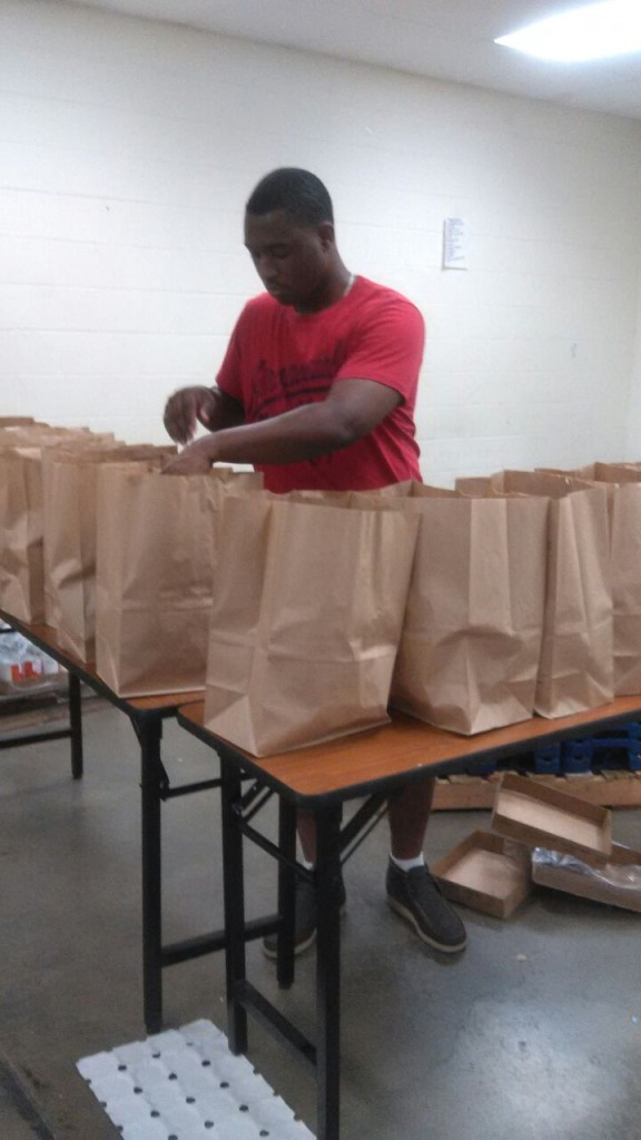 Man putting food items in a bag